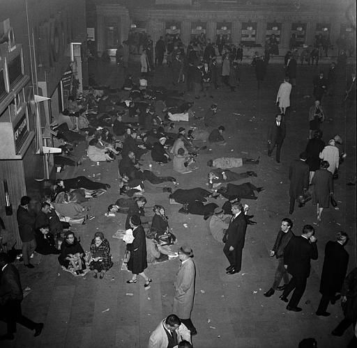 <div class='meta'><div class='origin-logo' data-origin='none'></div><span class='caption-text' data-credit='AP Photo / John Lent'>People sleep sitting and lying down at Grand Central Station's main waiting room in New York, during the massive power failure, Nov. 9, 1965.</span></div>