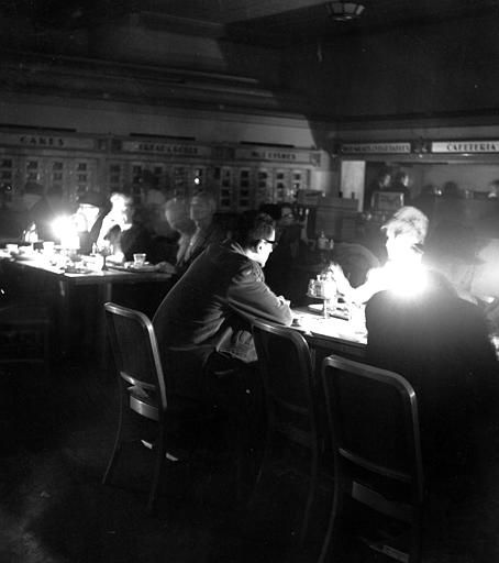 <div class='meta'><div class='origin-logo' data-origin='none'></div><span class='caption-text' data-credit='AP Photo/ File'>In this Nov. 9, 1965 file photo, New Yorkers eat dinner by candlelight in an automat in Manhattan in New York during a massive blackout 50 years ago.</span></div>