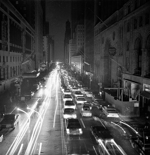 <div class='meta'><div class='origin-logo' data-origin='none'></div><span class='caption-text' data-credit='AP Photo/ Robert Goldberg'>FILE - In this Nov. 9, 1965, file photo, cars move slowly on 42nd Street in New York, after a massive blackout in the northeastern United States.</span></div>