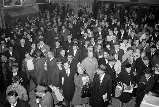 <div class='meta'><div class='origin-logo' data-origin='none'></div><span class='caption-text' data-credit='AP Photo/ John Lent'>FILE - In this Nov. 9, 1965 file photo, stranded commuters crowd the waiting area of the Long Island Railroad in New York's Pennsylvania Station during a massive power failure.</span></div>