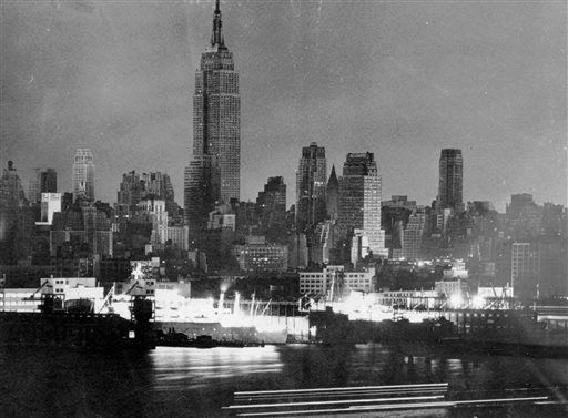 <div class='meta'><div class='origin-logo' data-origin='none'></div><span class='caption-text' data-credit='AP Photo/ Phil Lane'>In this Nov. 9, 1965, file photo, Manhattan skyscrapers and apartment buildings seen from across the river in New Jersey are dark shortly after 6 p.m.</span></div>