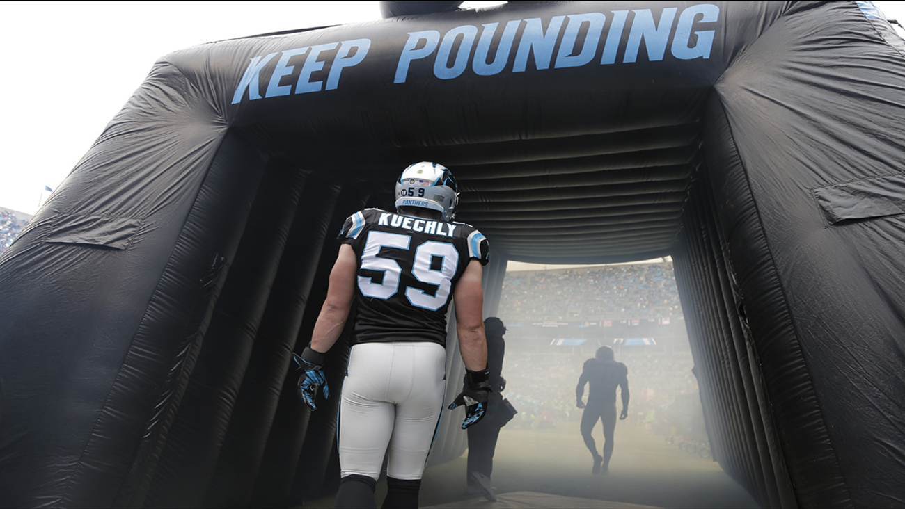 Carolina Panthers' Luke Kuechly (59) waits to be introduced before an NFL football game against the Green Bay Packers in Charlotte, N.C., Sunday, Nov. 8, 2015.