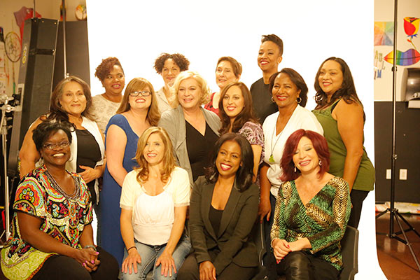 Veterans pose for a group photo after being treated to makeovers at Paul Mitchell - The School in Sherman Oaks on Monday, Nov. 10, 2015.