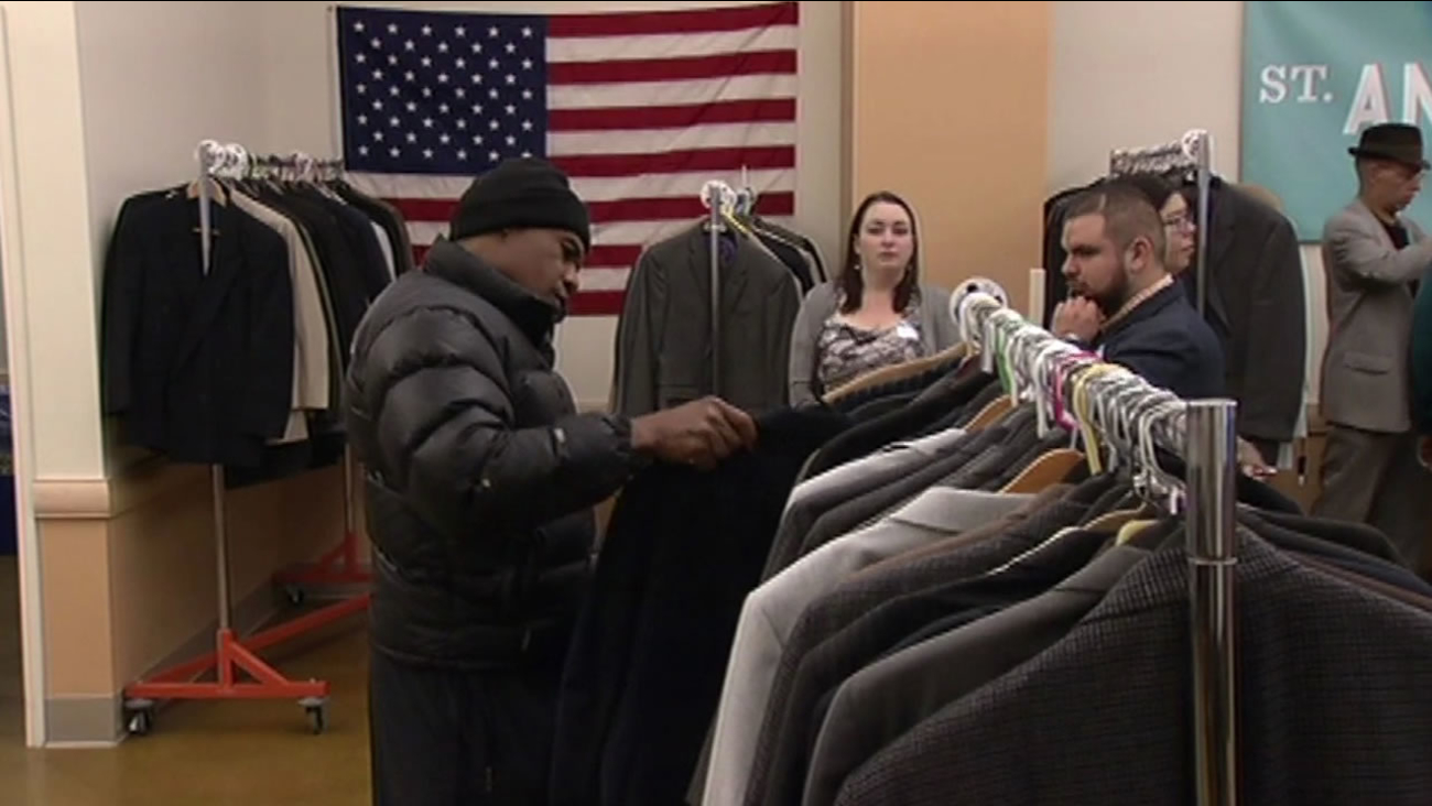 A veteran sifts through free clothing at the Suits For Service event at Saint Anthony's Church in San Francisco Nov. 10, 2015.