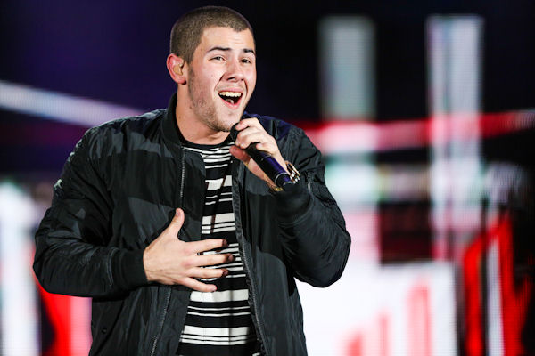 <div class='meta'><div class='origin-logo' data-origin='none'></div><span class='caption-text' data-credit='Rich Fury/Invision/AP'>Nick Jonas will appear in his first solo performance during the American Music Awards.</span></div>