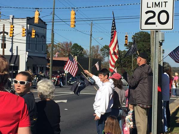 <div class='meta'><div class='origin-logo' data-origin='none'></div><span class='caption-text' data-credit='WTVD Photo/ Nicole Carr, Reporter'>Veterans Day Parade in Harnett County</span></div>