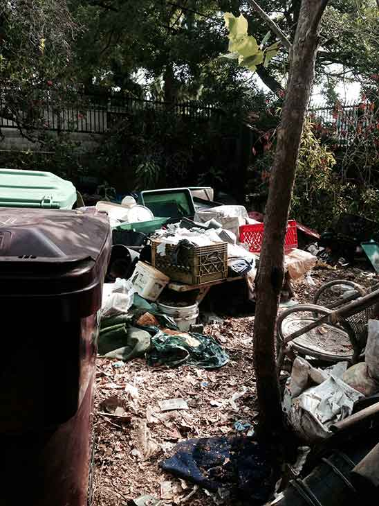 The front yard of a home with hoarding conditions in Santa Ana on the 600 block of E. Myrtle, photo courtesy the Santa Ana Police Department.