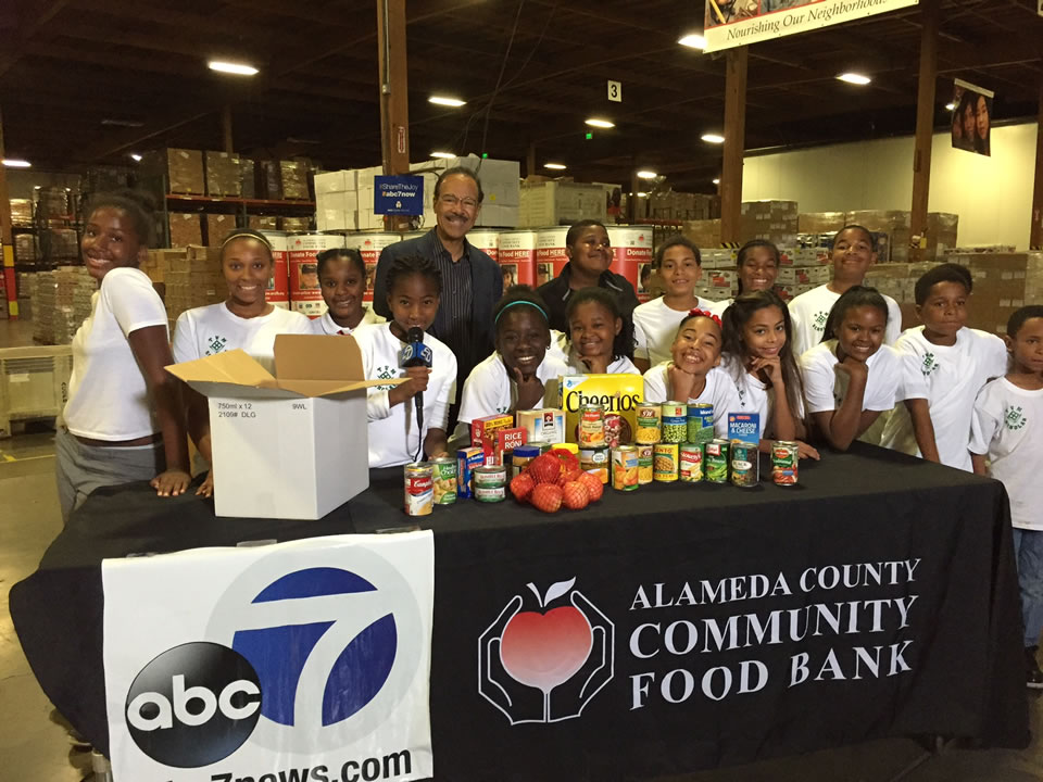 "<div class=""meta image-caption""><div class=""origin-logo origin-image none""><span>none</span></div><span class=""caption-text"">Young volunteers with Union City-based The Village Method stand with ABC7's Spencer Christian at the Alameda County Community Food Bank in Oakland, Calif. on November 11, 2015. (KGO-TV)</span></div>"