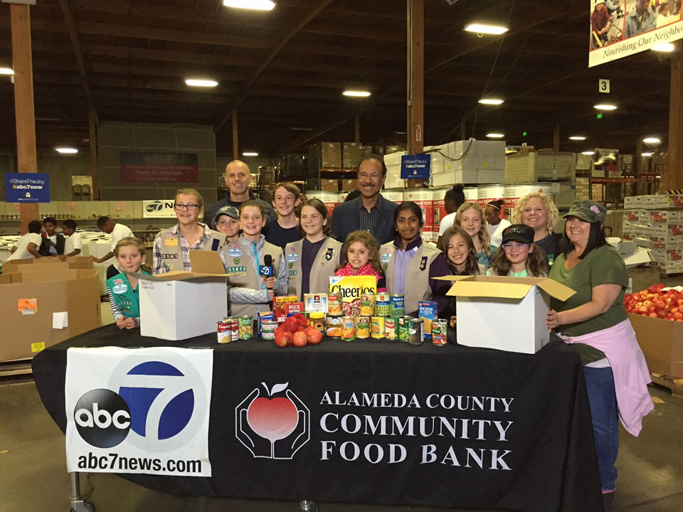"<div class=""meta image-caption""><div class=""origin-logo origin-image none""><span>none</span></div><span class=""caption-text"">Girl Scout Troop 31413 Crossroads Service Unit out of Dublin stand with ABC7's Spencer Christian at the Alameda County Community Food Bank in Oakland, Calif. on November 11, 2015. (KGO-TV)</span></div>"