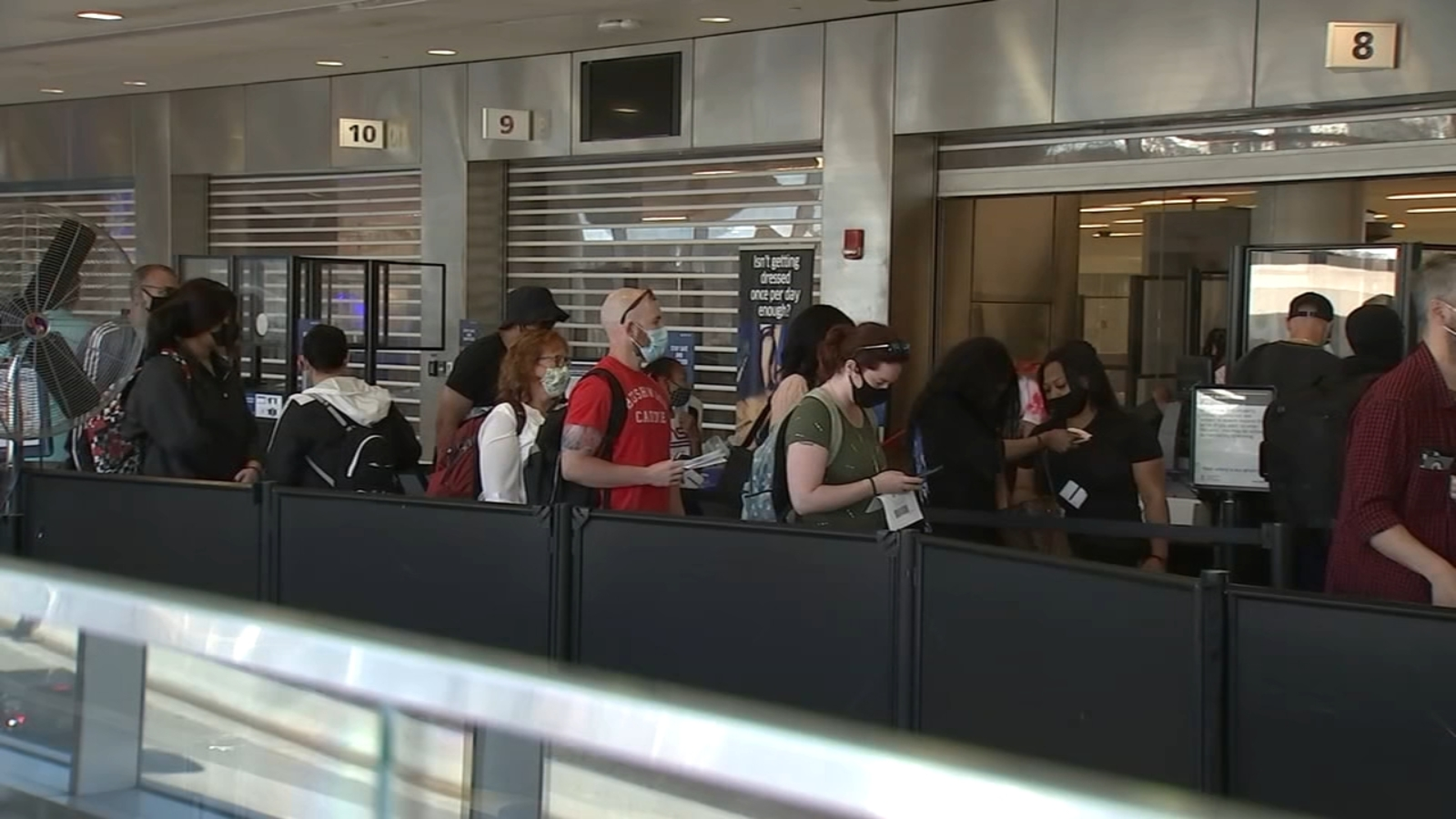 Travelers at Philadelphia International Airport react to non-essential travel to Europe opening