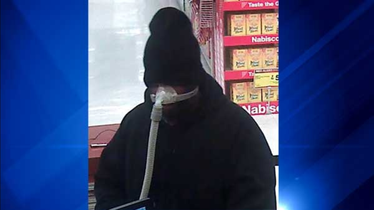 Police are looking for the man who robbed a bank in north suburban Waukegan while wearing a breathing mask.