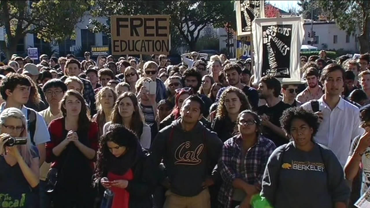 "FILE - A demonstrator is seen carrying a sign that reads ""free education"" in Berkeley, Calif. in this undated image."
