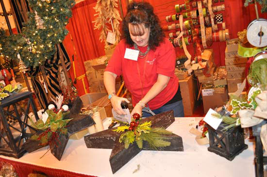 "<div class=""meta image-caption""><div class=""origin-logo origin-image none""><span>none</span></div><span class=""caption-text"">A woman works on a decoration at the Houston Ballet Nutcracker Market (KTRK Photo/ Amanda Cochran)</span></div>"