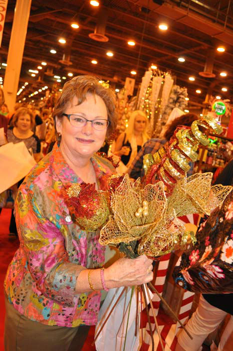 "<div class=""meta image-caption""><div class=""origin-logo origin-image none""><span>none</span></div><span class=""caption-text"">A woman shows off her purchases at the Houston Ballet Nutcracker Market (KTRK Photo/ Amanda Cochran)</span></div>"