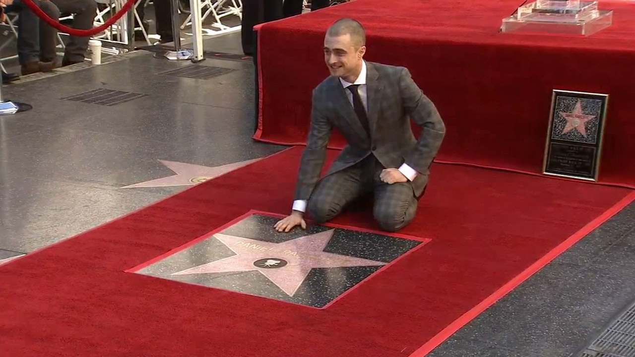 Daniel Radcliffe poses for the cameras after his new Hollywood Walk of Fame star was unveiled on Thursday, Nov. 12, 2015.