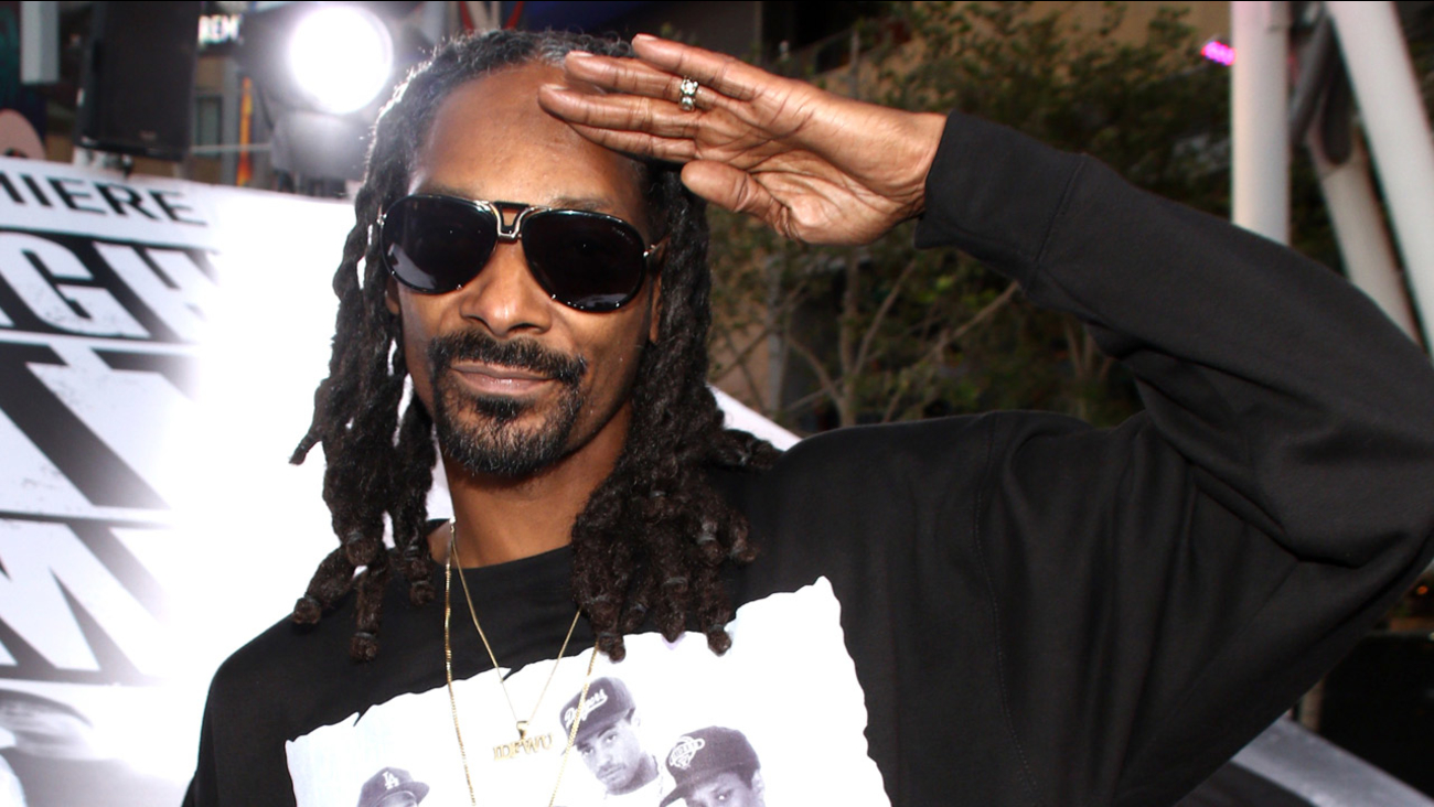"""Snoop Dogg arrives at the Los Angeles premiere of """"Straight Outta Compton"""" at the Microsoft Theater on Monday, Aug. 10, 2015."""