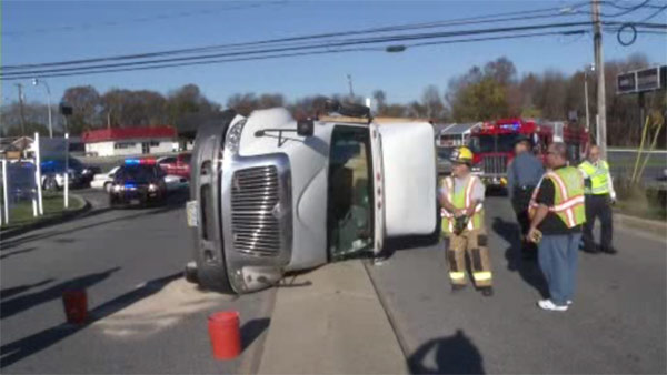 Driver trapped after tractor-trailer overturns in New Castle