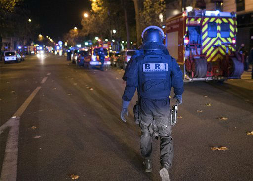 "<div class=""meta image-caption""><div class=""origin-logo origin-image none""><span>none</span></div><span class=""caption-text"">An elite police officer arrivesoutside the Bataclan theater  in Paris, France, Wednesday, Nov. 13, 2015 (AP Photo/ Kamil Zihnioglu)</span></div>"