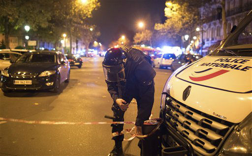 "<div class=""meta image-caption""><div class=""origin-logo origin-image none""><span>none</span></div><span class=""caption-text"">A police officer secures the area outside the Bataclan theater  in Paris, France (AP Photo/ Kamil Zihnioglu)</span></div>"