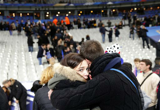 "<div class=""meta image-caption""><div class=""origin-logo origin-image none""><span>none</span></div><span class=""caption-text"">A supporter conforts a friend after invading the pitch of the Stade de France stadium at the end of the international friendly soccer match (AP Photo/ Christophe Ena)</span></div>"