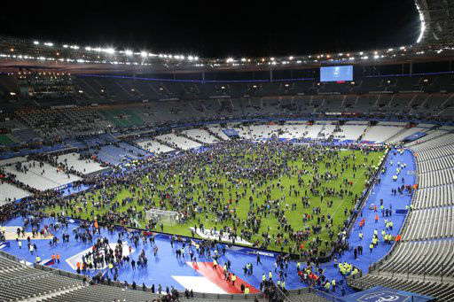 "<div class=""meta image-caption""><div class=""origin-logo origin-image none""><span>none</span></div><span class=""caption-text"">Spectators invade the pitch of the Stade de France stadium after the international friendly soccer France against Germany (AP Photo/ Michel Euler)</span></div>"