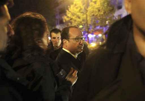 <div class='meta'><div class='origin-logo' data-origin='none'></div><span class='caption-text' data-credit='AP Photo / Thibault Camus'>French President Francois Hollande arrives to visit the site of the the Bataclan theater after a shooting in Paris, Friday Nov. 13, 2015.</span></div>
