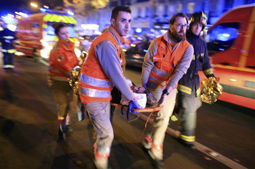 <div class='meta'><div class='origin-logo' data-origin='none'></div><span class='caption-text' data-credit='AP Photo / Thibault Camus'>A woman is being evacuated from the Bataclan theater after a shooting in Paris, Friday Nov. 13, 2015.</span></div>