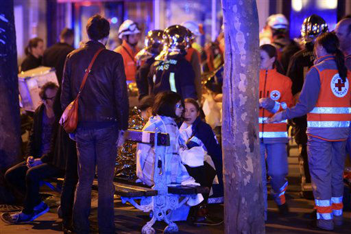 <div class='meta'><div class='origin-logo' data-origin='none'></div><span class='caption-text' data-credit='AP Photo / Thibault Camus'>People rest on a bench after being evacuated from the Bataclan theater after a shooting in Paris, Friday Nov. 13, 2015.</span></div>