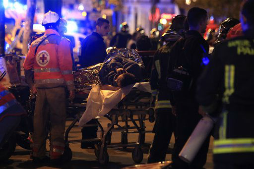 <div class='meta'><div class='origin-logo' data-origin='none'></div><span class='caption-text' data-credit='AP Photo / Thibault Camus'>A person is being evacuated after a shooting, outside the Bataclan theater in Paris, Friday Nov. 13, 2015.</span></div>