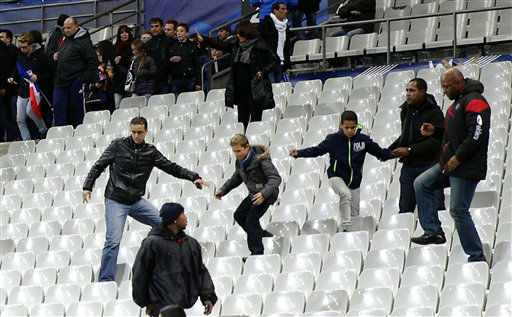 <div class='meta'><div class='origin-logo' data-origin='none'></div><span class='caption-text' data-credit='AP Photo / Christophe Ena'>Soccer fans leave the Stade de France stadium after an international friendly soccer match in Saint Denis, outside Paris, Friday, Nov. 13, 2015.</span></div>