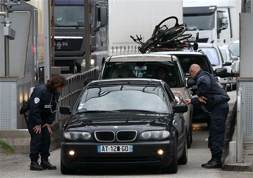 <div class='meta'><div class='origin-logo' data-origin='none'></div><span class='caption-text' data-credit='AP Photo/ Bob Edme'>French police officers check vehicles leaving France at the border crossing between France and Spain in Biriatou, as southwestern France, Saturday, Nov. 14, 2015.</span></div>