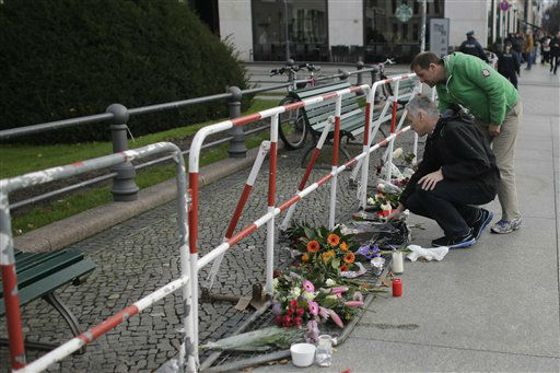 "<div class=""meta image-caption""><div class=""origin-logo origin-image none""><span>none</span></div><span class=""caption-text"">Two men lay down flowers to mourn for the victims killed in the Friday's attacks in Paris, France, in front of the French Embassy in Berlin, Saturday, Nov. 14, 2015. (AP Photo/ Markus Schreiber)</span></div>"