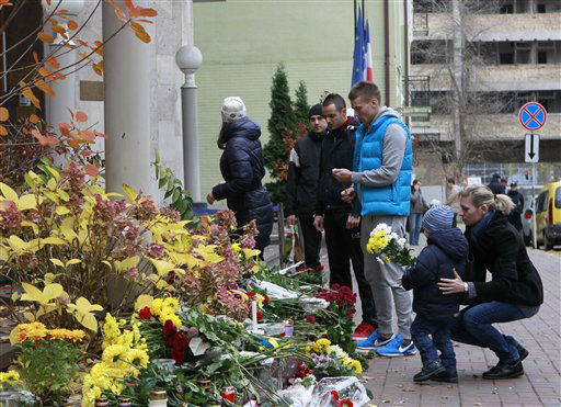 "<div class=""meta image-caption""><div class=""origin-logo origin-image none""><span>none</span></div><span class=""caption-text"">People lay flowers in front of the French Embassy in Kiev, Ukraine, Saturday, Nov. 14, 2015, to mourn the victims in Friday's Paris attacks. (AP Photo/ Sergei Chuzavkov)</span></div>"