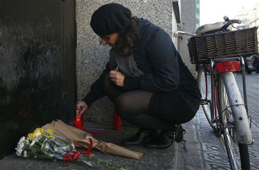 "<div class=""meta image-caption""><div class=""origin-logo origin-image none""><span>none</span></div><span class=""caption-text"">A woman lights a candle outside the French consulate in Barcelona, Spain, Saturday Nov. 14, 2015, for the victims in Friday's Paris attacks. (AP Photo/ Manu Fernandez)</span></div>"