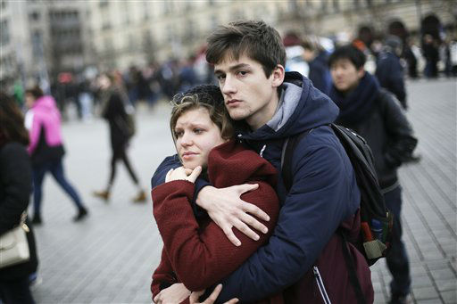 "<div class=""meta image-caption""><div class=""origin-logo origin-image none""><span>none</span></div><span class=""caption-text"">A young couple mourns for the victims killed in the Friday's attacks in Paris, France, in front of the French Embassy in Berlin, Saturday, Nov. 14, 2015. (AP Photo/ Markus Schreiber)</span></div>"