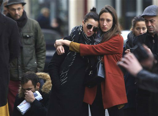 "<div class=""meta image-caption""><div class=""origin-logo origin-image none""><span>none</span></div><span class=""caption-text"">Women comfort each other as they stand in front of the Carillon cafe, in Paris, Saturday, Nov.14, 2015. (AP Photo/ Thibault Camus)</span></div>"