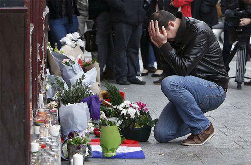 "<div class=""meta image-caption""><div class=""origin-logo origin-image none""><span>none</span></div><span class=""caption-text"">A man holds his head in his hands as he lays flowers in front of the Carillon cafe, in Paris, Saturday, Nov.14, 2015. (AP Photo/ Thibault Camus)</span></div>"
