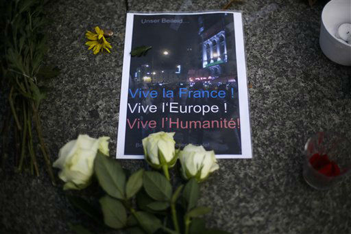 "<div class=""meta image-caption""><div class=""origin-logo origin-image none""><span>none</span></div><span class=""caption-text"">A poster and flowers to mourn for the victims killed in the Friday's attacks in Paris, France, sit in front of the French Embassy  in Berlin, Saturday, Nov. 14, 2015. (AP Photo/ Markus Schreiber)</span></div>"