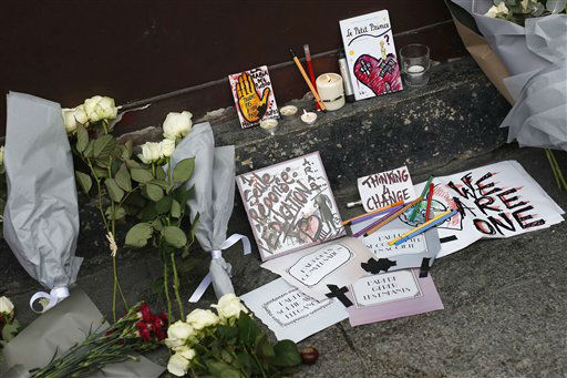 "<div class=""meta image-caption""><div class=""origin-logo origin-image none""><span>none</span></div><span class=""caption-text"">Cards, candles and flowers are placed in front of the Carillon cafe in Paris Saturday Nov. 14, 2015. (AP Photo/ Jerome Delay)</span></div>"
