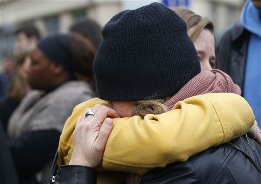 "<div class=""meta image-caption""><div class=""origin-logo origin-image none""><span>none</span></div><span class=""caption-text"">People hug in the street in front  of the Carillon cafe and the Petit Cambodge restaurant  in Paris Saturday Nov. 14, 2015. (AP Photo/ Jerome Delay)</span></div>"