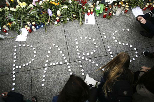 "<div class=""meta image-caption""><div class=""origin-logo origin-image none""><span>none</span></div><span class=""caption-text"">Young women have formed  the word Paris with candles to mourn for the victims killed in  Friday's attacks in Paris, France. (AP Photo/ Markus Schreiber)</span></div>"