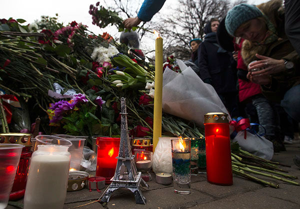 "<div class=""meta image-caption""><div class=""origin-logo origin-image none""><span>none</span></div><span class=""caption-text"">People lay flowers and light candles in front of the French embassy in Moscow, Russia, Saturday, Nov. 14, 2015, for the victims of the Paris attacks on Friday. (AP Photo/ Pavel Golovkin)</span></div>"