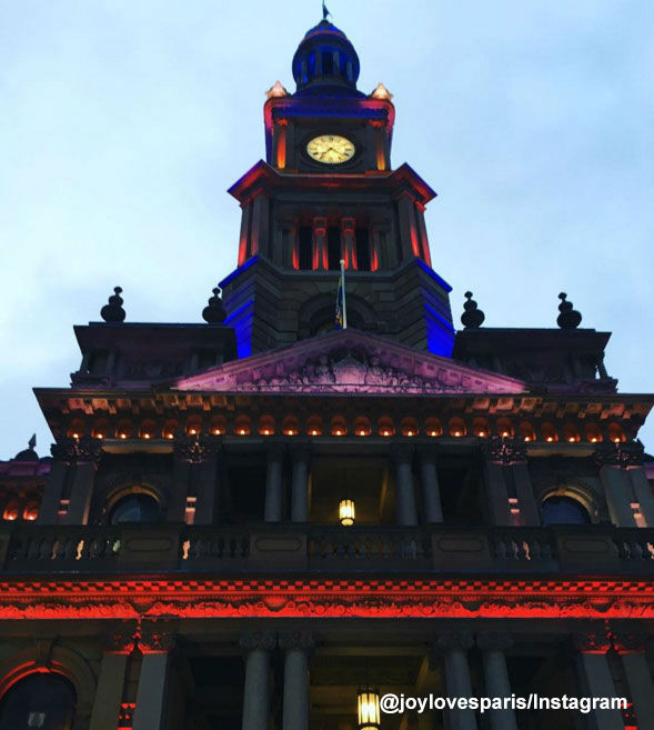 "<div class=""meta image-caption""><div class=""origin-logo origin-image none""><span>none</span></div><span class=""caption-text"">Sydney Townhall is lit in the colors of the French flag.</span></div>"