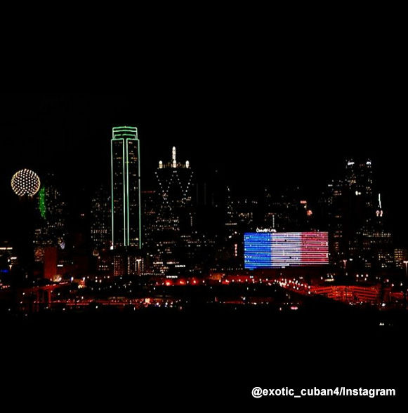 "<div class=""meta image-caption""><div class=""origin-logo origin-image none""><span>none</span></div><span class=""caption-text"">The Omni Hotel Dallas is lit blue, white and red.</span></div>"