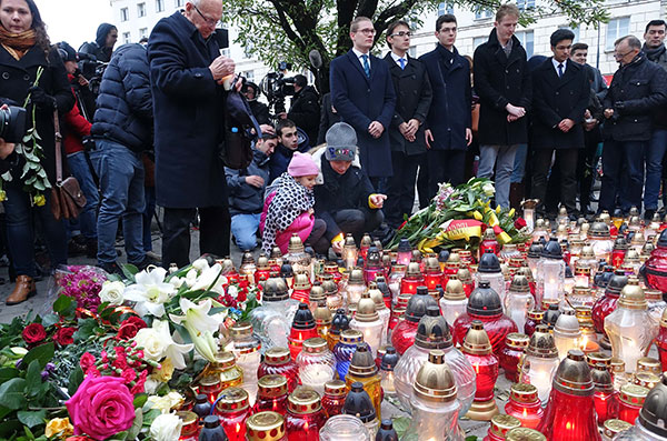 "<div class=""meta image-caption""><div class=""origin-logo origin-image ap""><span>AP</span></div><span class=""caption-text"">eople lay flowers and light candles for the victims of the deadly attacks in Paris, outside the French embassy in Warsaw, Poland, Saturday, Nov. 14, (AP Photo/Alik Keplicz)</span></div>"