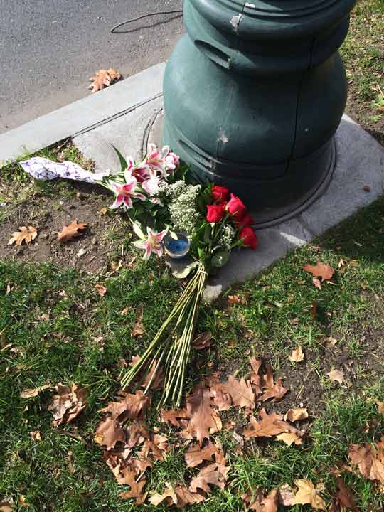 """<div class=""""meta image-caption""""><div class=""""origin-logo origin-image none""""><span>none</span></div><span class=""""caption-text"""">Flowers and a candle are placed at the base of the French flagpole on the Ben Franklin Parkway on Saturday, Nov. 14.</span></div>"""