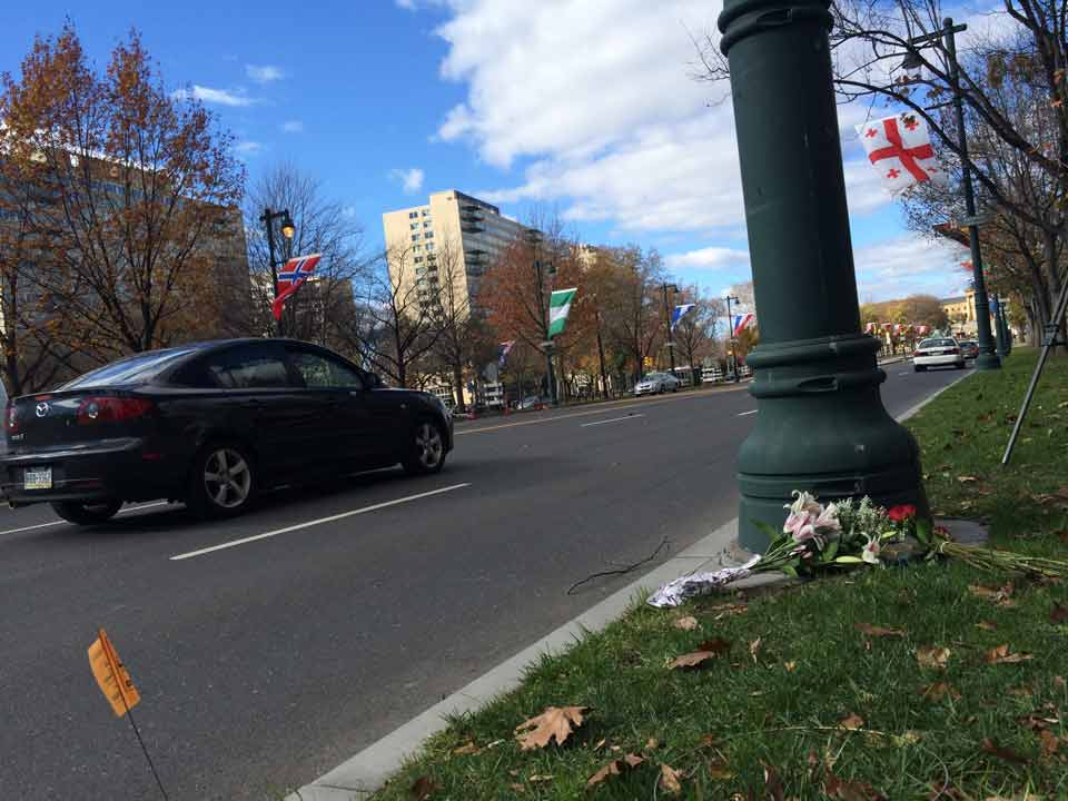 """<div class=""""meta image-caption""""><div class=""""origin-logo origin-image wpvi""""><span>WPVI</span></div><span class=""""caption-text"""">Flowers and a candle are placed at the base of the French flagpole on the Ben Franklin Parkway on Saturday, Nov. 14.</span></div>"""