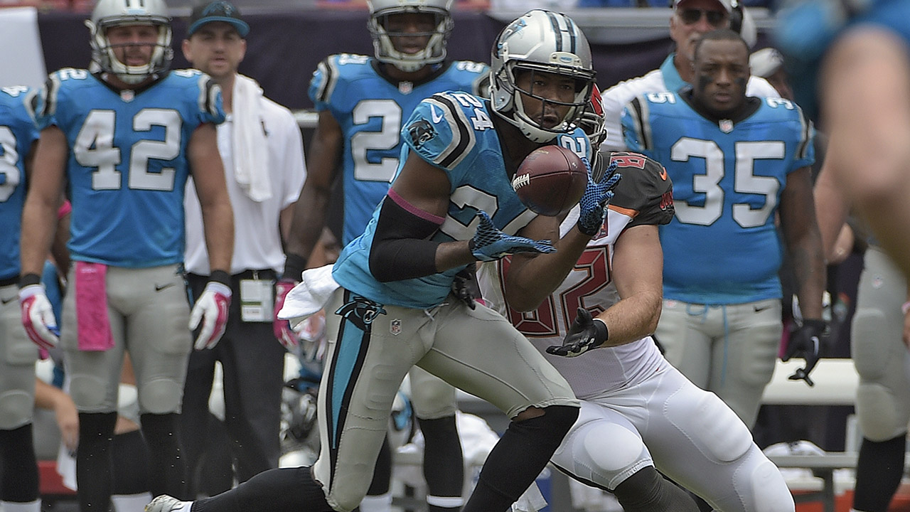 Carolina Panthers cornerback Josh Norman (24) intercepts a pass intended for Tampa Bay Buccaneers tight end Brandon Myers (82) and returns it 46-yards for a touchdown