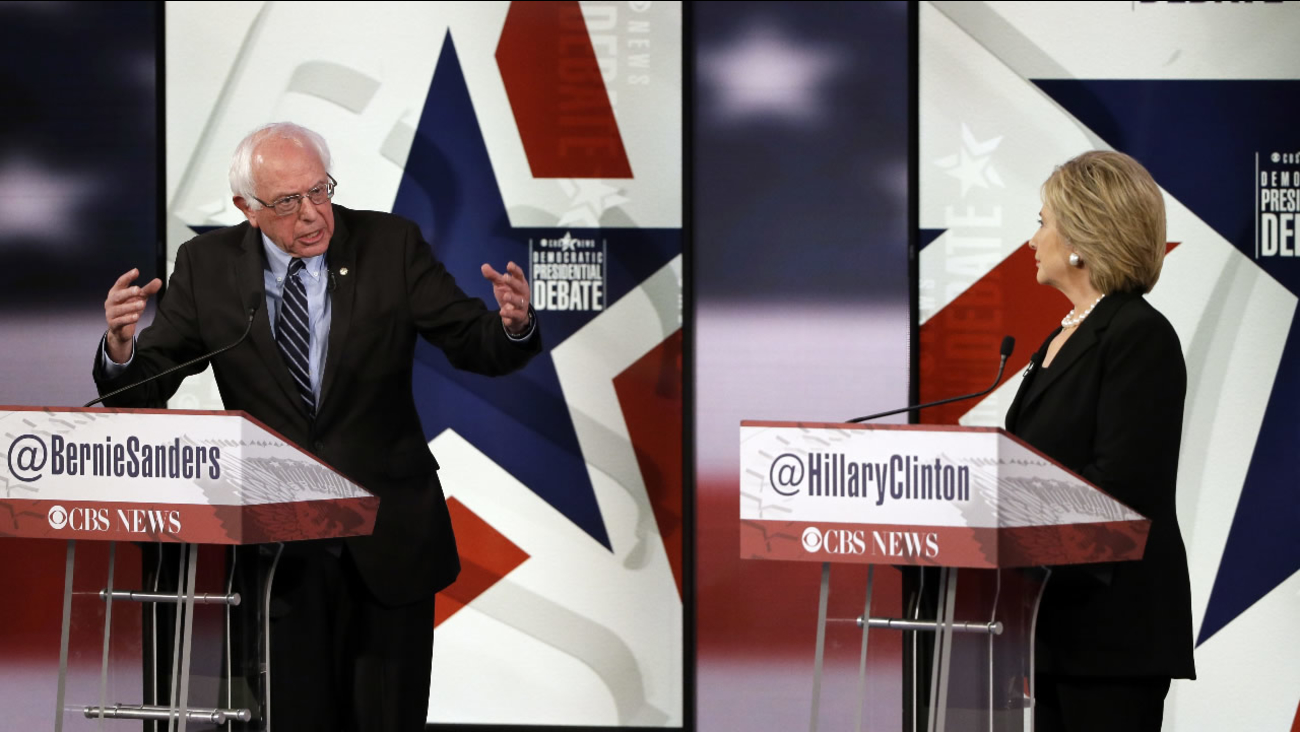 Bernie Sanders, left, makes a point as Hillary Rodham Clinton listens during a Democratic presidential primary debate, Saturday, Nov. 14, 2015, in Des Moines, Iowa.