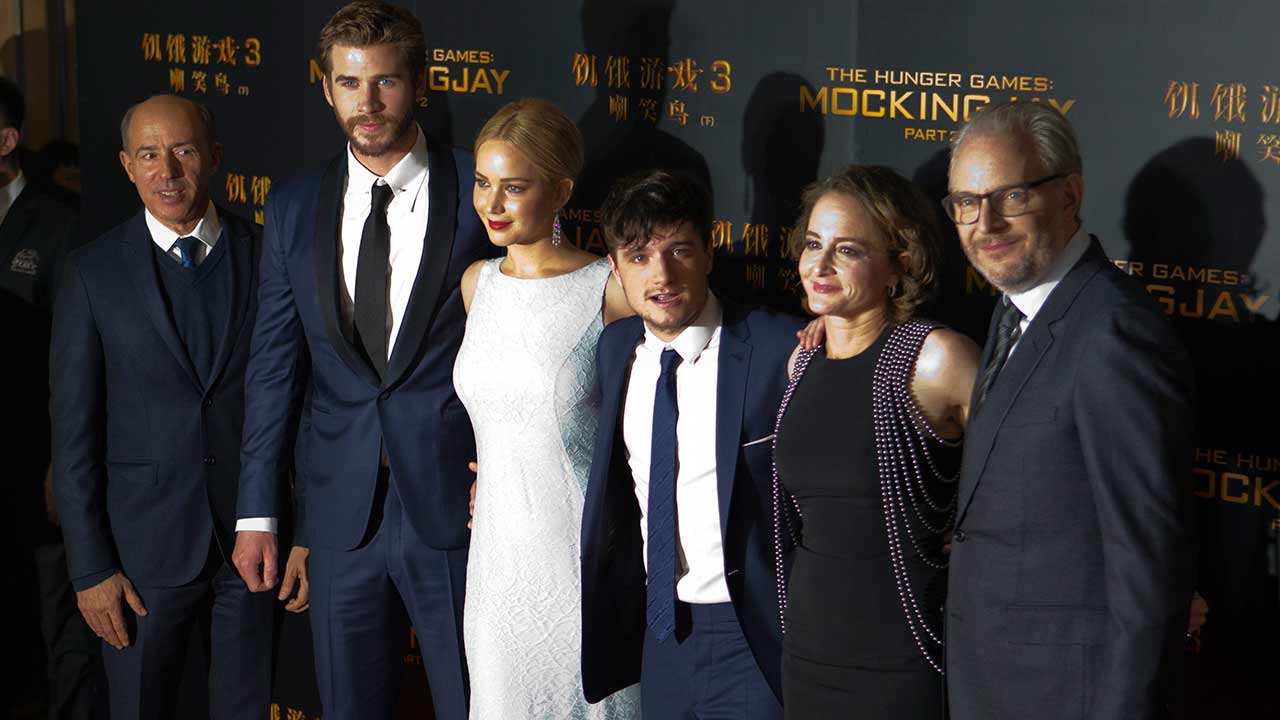Jon Kilik, Liam Hemsworth, Jennifer Lawrence, Josh Hutcherson, Nina Jacobson and Francis Lawrence pose for photographers at an event for 'The Hunger Games: Mockingjay - Part 2.'